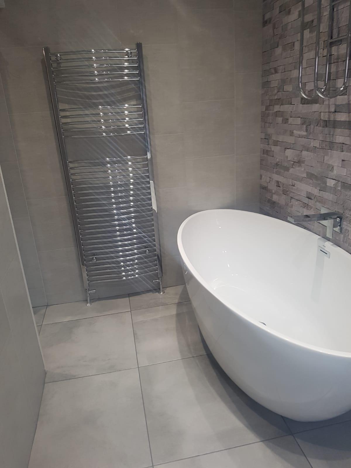 Bath and towel radiator