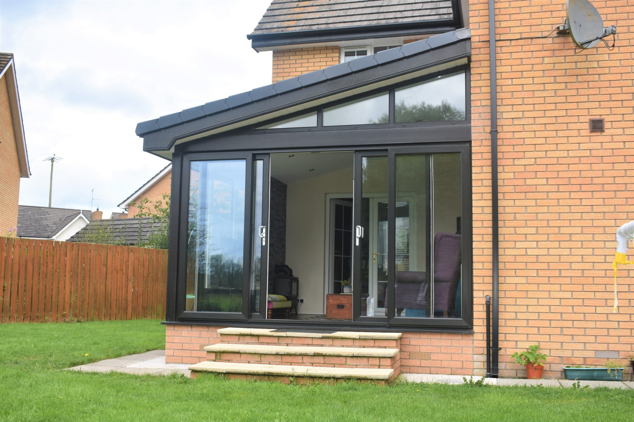 Grey contemporary sunroom
